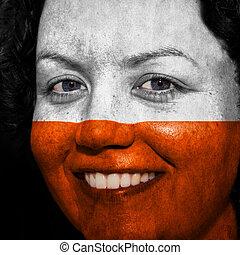 donna, con, bandiera, dipinto, su, lei, faccia, mostrare, polonia, sostegno