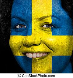 donna, con, bandiera, dipinto, su, lei, faccia, mostrare, svezia, sostegno