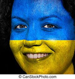donna, con, bandiera, dipinto, su, lei, faccia, mostrare, ucraina, sostegno