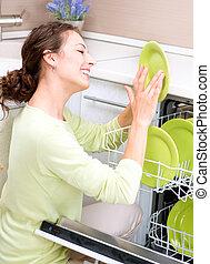 donna, giovane, dishwasher., housework., wash-up, cucina