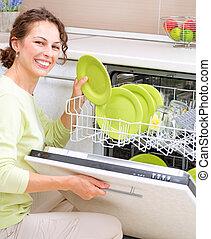 donna, giovane, housework., dishwasher., wash-up, cucina