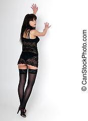 donna, in, nero, biancheria intima, leva piedi, con, suo, indietro