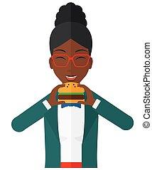 donna mangia, hamburger.