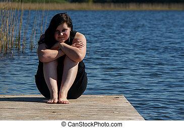 donna meditando, giovane, molo, seduta