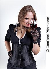 donna sorridente, con, vino rosso