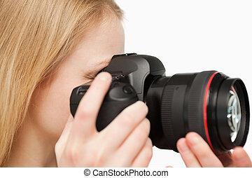 donna, su, giovane, macchina fotografica, tenere