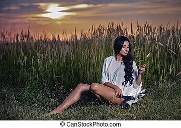 donna, tramonto, erba