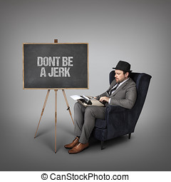 Dont be a jerk text on blackboard with businessman sitting...