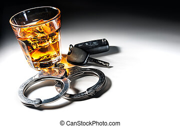 dont drink and drive - Whiskey with car keys and handcuffs...