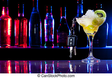 Don't drive after drink - car keys and the cocktail glass