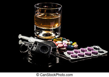 Don't Drive Drink - Alchohol,pills and car keys isolated on...
