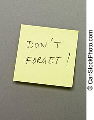 """Don`t Forget - Adhesive Note with """"Don`t forget"""" wrote on it"""