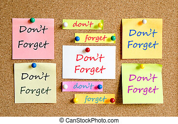 Don't Forget Concept - Colorful sticky notes on cork board...