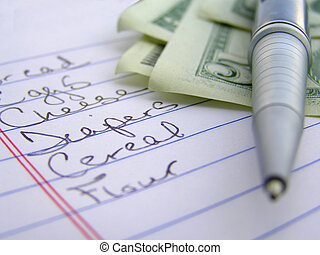 macro of shopping list money and pen