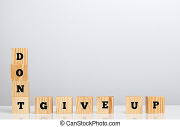 Dont Give Up Spelled in Letter Blocks - Don't Give Up...