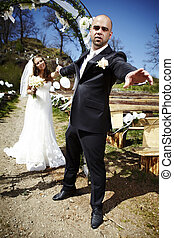 Don?t go away! - Nice young couple on wedding day - bride in...