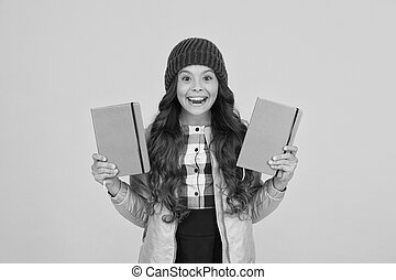 Dont judge books by cover. Happy girl hold books yellow background. Little girl enjoy reading library books. Cute bookworm. Knowledge and information. Reading lesson. Books are just the beginning