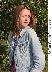 Don't Look Back - a beautiful girl in denim, looking over ...