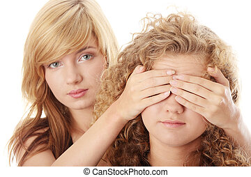 Don't look - censorship concept - two teen girls isolated on...