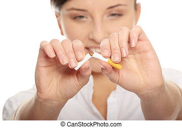 Don't smoke - Young woman breaking cigarette over white ...