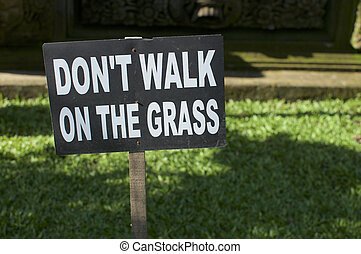 """""""Don't walk on the grass"""" signboard"""