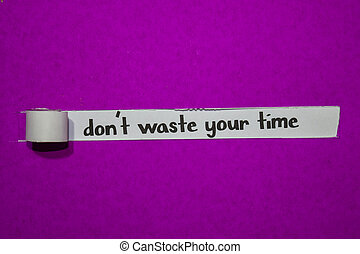 Don't waste your time, Inspiration, Motivation and business concept on purple torn paper