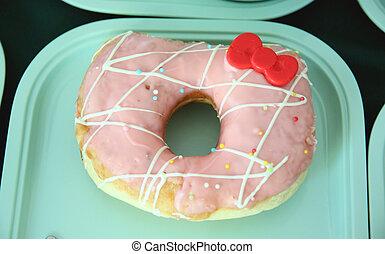 Donut in a green dish.