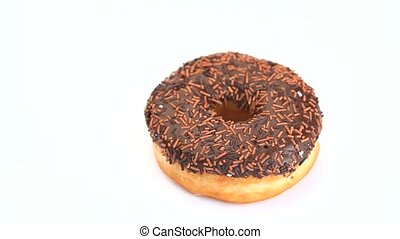 Donut with chocolate icing rotating on a white background