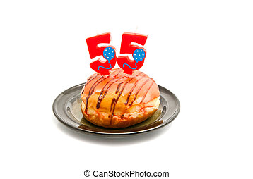 donut with fifty five years birthday candle on white