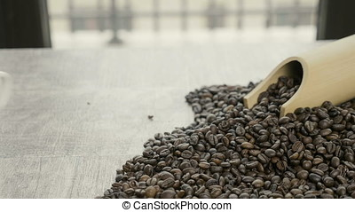 Donuts and cup of coffee on roasted coffee beans