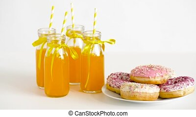 donuts and lemonade or juice in glass bottles - birthday...