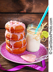 donuts and milk - homemade donuts with pink icing and...