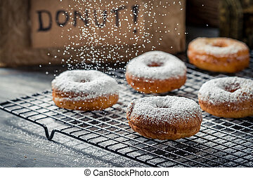 Donuts decorated with icing sugar