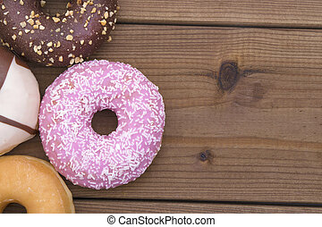 donuts on a background of old wood