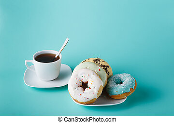 Donuts on aquamarine background