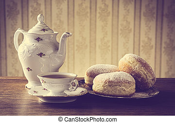 Donuts on tray with cup of coffee in old-fashioned - Three...