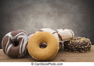 donuts stacked in vintage wood with abstract background