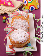 donuts with icing sugar and festive decoration