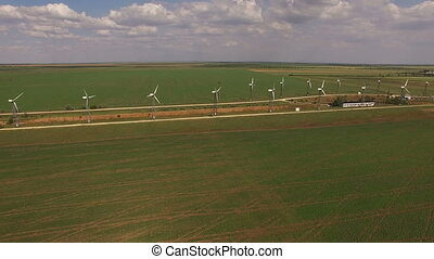 Aerial view of the landscape with wind farms.