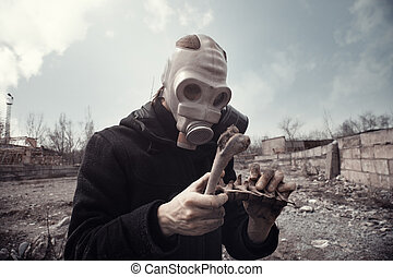 Doom - Man in gas mask holding residual bones after doomsday