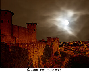 Dooms city - Carcasonne castle city in france with a storm...