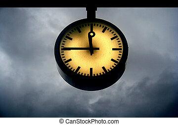 Doomsday Clock - Clock at a quarter to twelve with a...