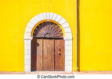 door and stairs on yellow wall