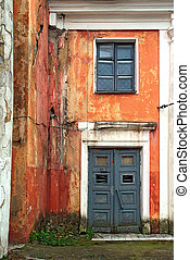 door and window in old destroyed house
