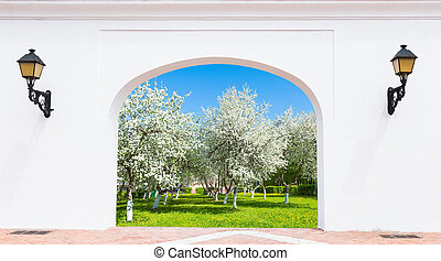 Door arch spring garden - doorway arch with a flashlight on...