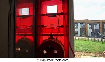 Door blower test equipment mounted on townhouse door. Certificating energy efficient house. Gimbal movement up shot.