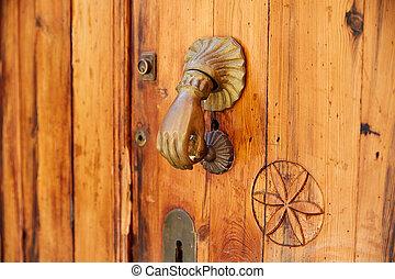 Door brass knock hand shape in Spain