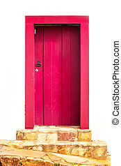 Door - bright red wooden door in the historic town,...