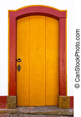 Door - bright yellow wooden door in the historic town,...