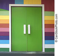 Colorful wooden door of the wood-paneled walls.